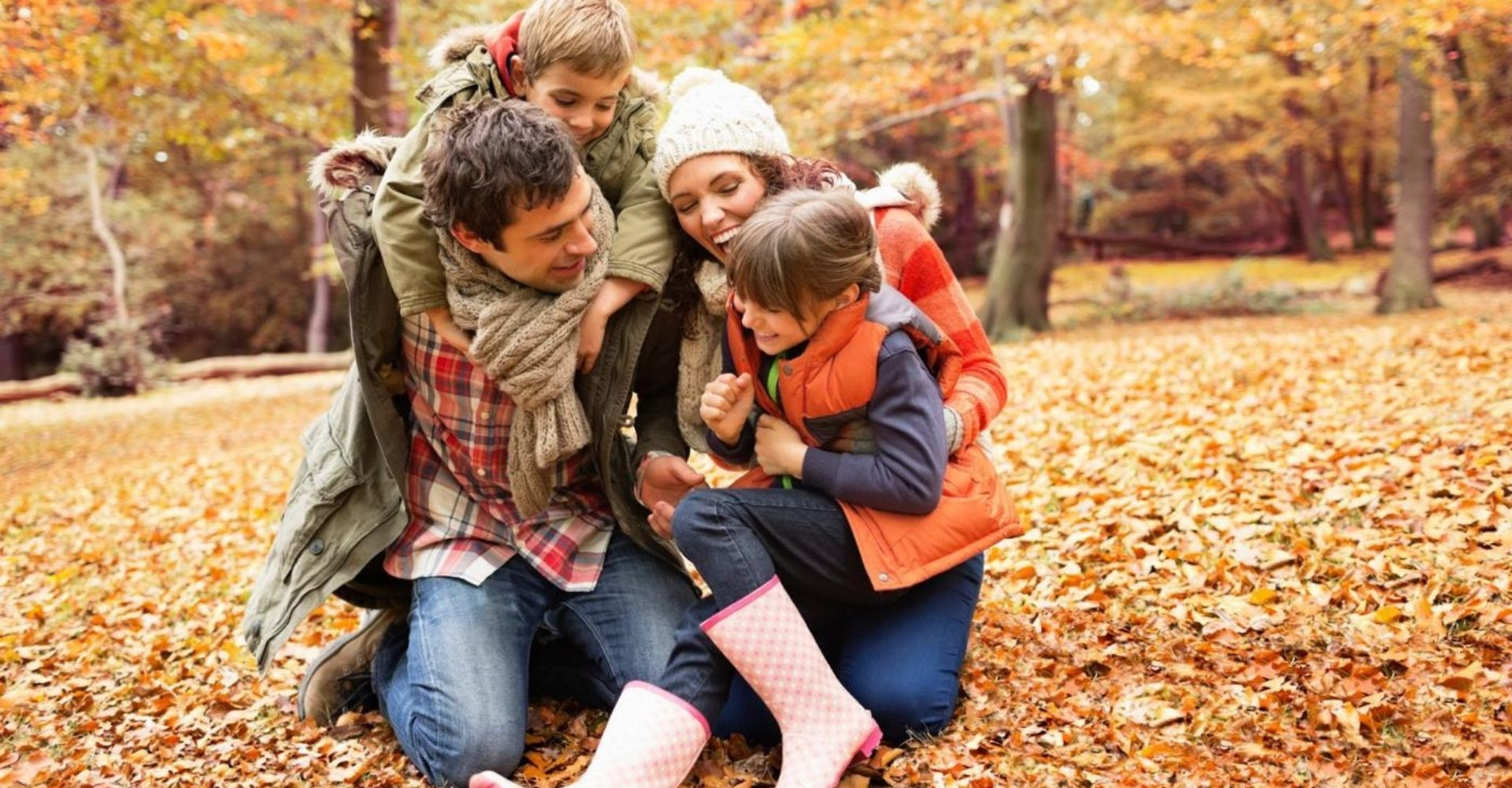 Family wearing warm clothing on self catering holiday